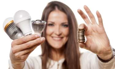 Girl saving money by using energy efficient lighting.