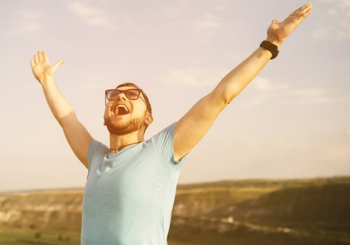 Man celebrates after switching energy supplier and saving money.